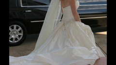 Paloma Blanca ' CA05313' size 6 used wedding dress side view on bride