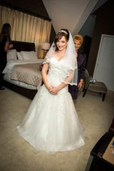 Custom 'Melli' size 6 used wedding dress front view on bride