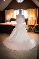 Custom 'Melli' size 6 used wedding dress back view on bride