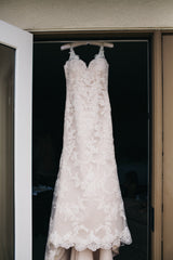 Moonlight Couture 'Net Lace' size 4 used wedding dress front view on hanger