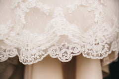 Moonlight Couture 'Net Lace' size 4 used wedding dress view of hemline