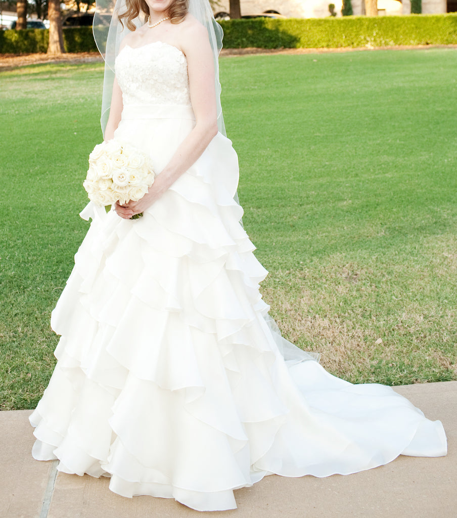 Jim Hjelm 'Semi Sweetheart' size 6 used wedding dress side view on bride