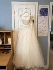 Cosmobella '7693' size 14 sample wedding dress front view on hanger