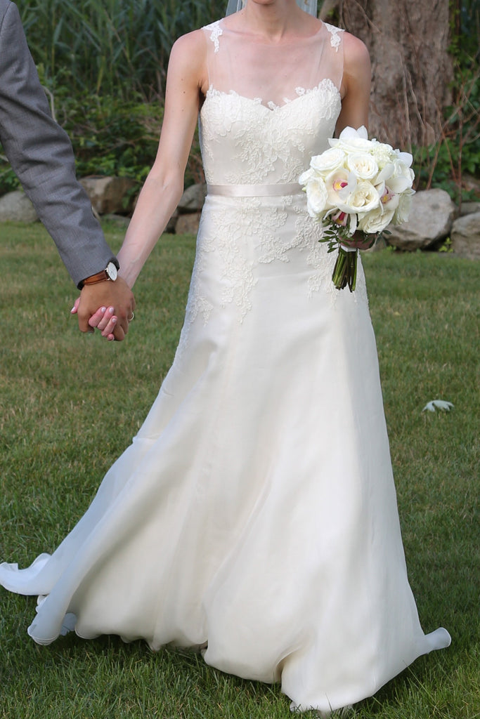 Christos 'Ophelia' size 4 used wedding dress front view on bride