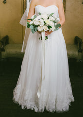 Robert Bullock 'Galina' size 10 used wedding dress front view on bride