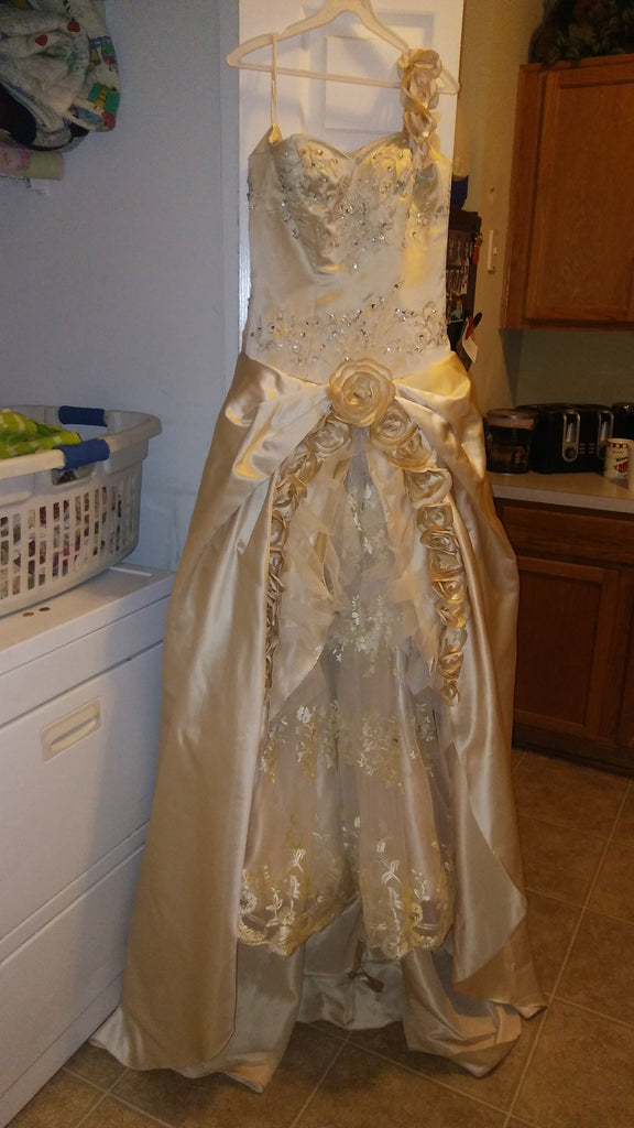 Custom 'Champagne' size 10 used wedding dress front view on hanger