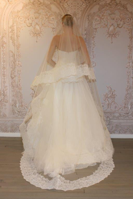 Monique Lhuillier 'Whisper with veil' size 4 used wedding dress back view on bride