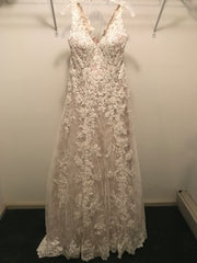 Justin Alexander 'Allover Lace/Illusion' size 14 new wedding dress front view on hanger