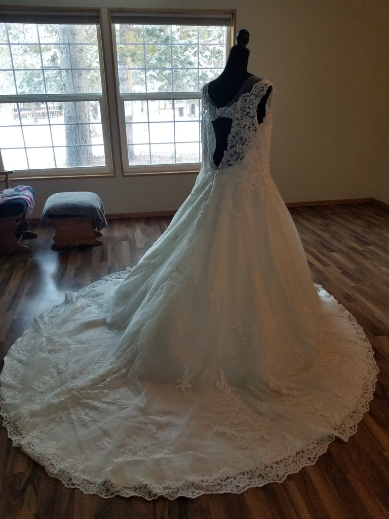 Maggie Sottero 'Ballgown Princess' size 22 new wedding dress back view on mannequin