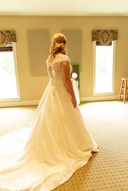Maggie Sottero 'Kaitlyn' size 14 used wedding dress back view on bride