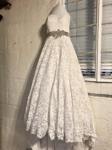 Justin Alexandr 'Corded Lace Ball Gown' size 10 used wedding dress front view on hanger
