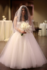 Pnina Tonai '4051' size 8 used wedding dress front view close up on bride