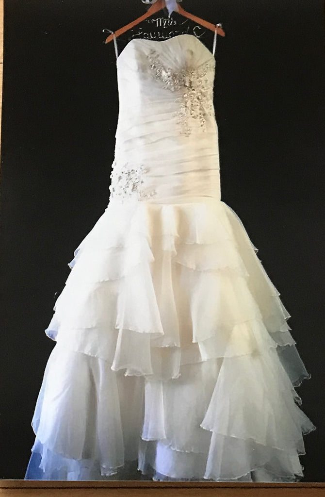 A.C.E. 'Sleeveless' size 6 used wedding dress front view on hanger