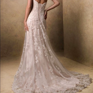 Maggie Sottero 'Emma' size 10 used wedding dress back view on model