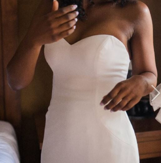 Custom 'Ivory Dress' size 8 used wedding dress front view on bride