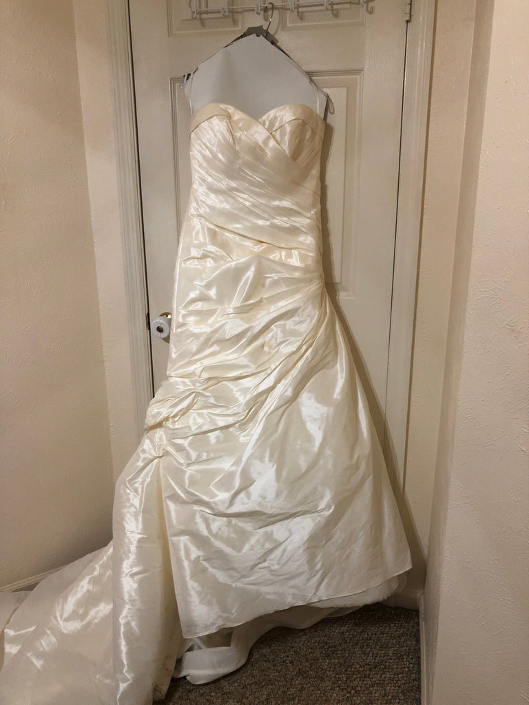 Mori Lee 'Beautiful Strapless' size 12 used wedding dress front view on hanger