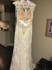 Eddy K '1131' size 4 used wedding dress back view on hanger