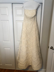 Vera Wang 'Ivory Strapless' size 12 used wedding dress front view on hanger