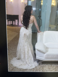 Demetrios '619' size 6 used wedding dress back view on bride