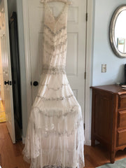 Amsale 'Kate' size 2 used wedding dress back view on hanger