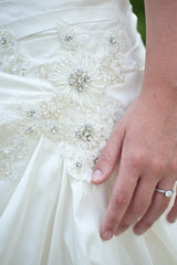 Blue 'Brigham' size 0 used wedding dress front view close up on bride