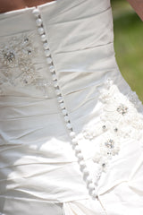 Blue 'Brigham' size 0 used wedding dress back view close up on bride