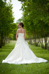 Blue 'Brigham' size 0 used wedding dress back view on bride