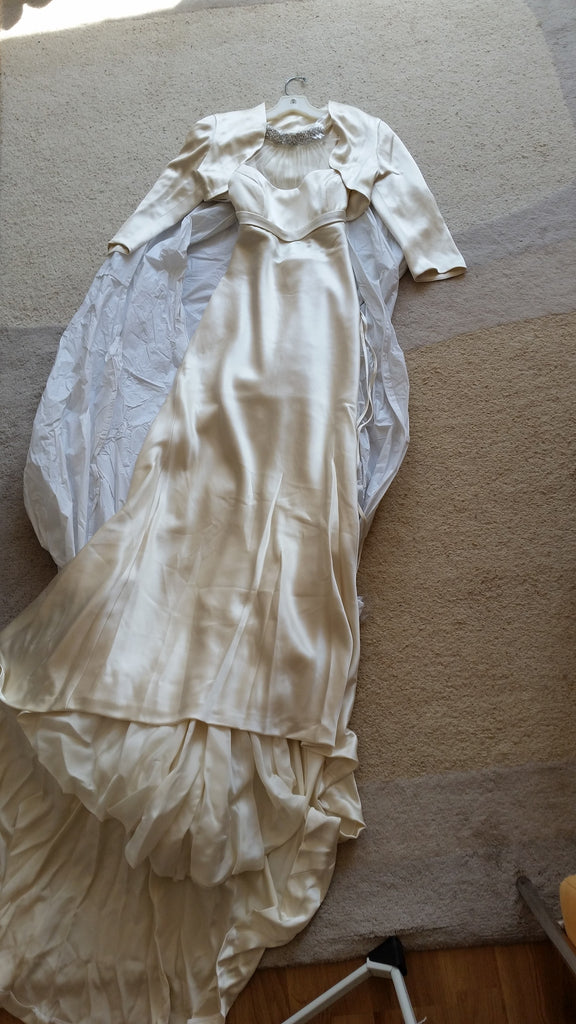 Rivini 'Eros' size 2 new wedding dress front view with jacket on hanger