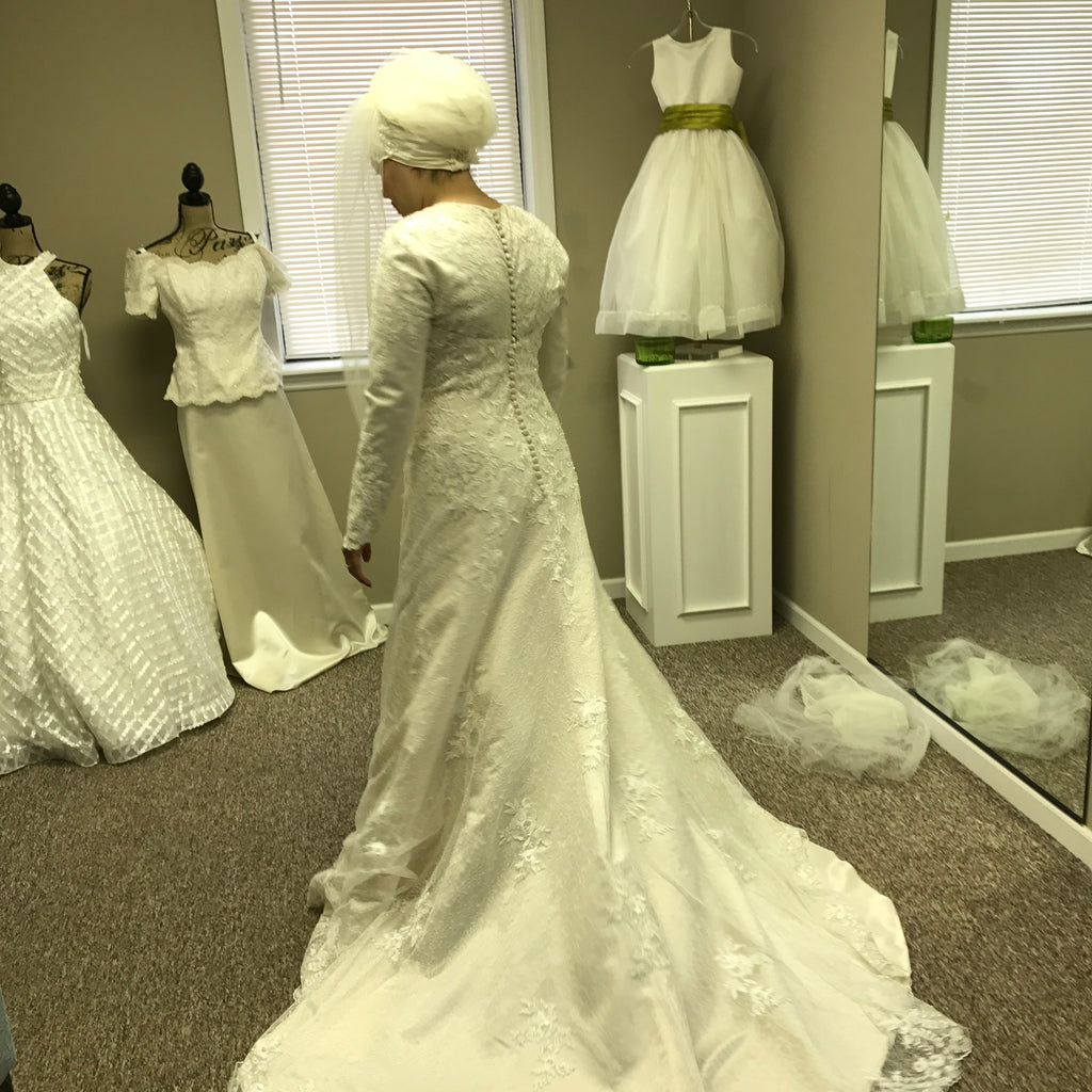 Elegant Bridal 'Gorgeous' size 12 new wedding dress back view on bride
