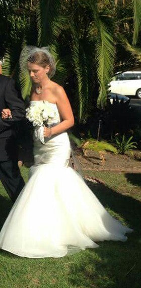Vera Wang 'Fit and Flare' size 4 used wedding dress side view on bride