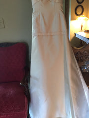 Rivini 'Silk' size 4 used wedding dress front view on hanger