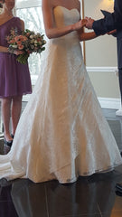 David's Bridal '10012471' size 2 used wedding dress side view on bride