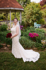 Maggie Sottero 'Londyn' size 4 used wedding dress side view on bride