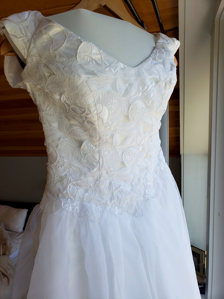Custom 'Georgette of Boston' size 6 used wedding dress front view on hanger