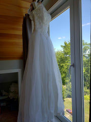 Custom 'Georgette of Boston' size 6 used wedding dress back view on hanger