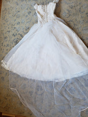 Custom 'Georgette of Boston' size 6 used wedding dress back view flat