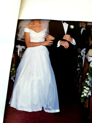 Custom 'Georgette of Boston' size 6 used wedding dress front view on bride