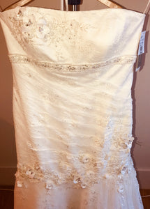 Oleg Cassini 'CWG377' size 14 new wedding dress front view on hanger