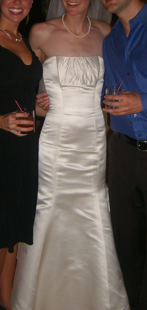 Custom 'Strapless' size 2 used wedding dress front view on bride