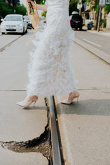 Marchesa 'Ostrich Feathered' size 4 used wedding dress side view on bride