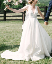Load image into Gallery viewer, BHLDN 'Octavia' size 4 used wedding dress front view on bride