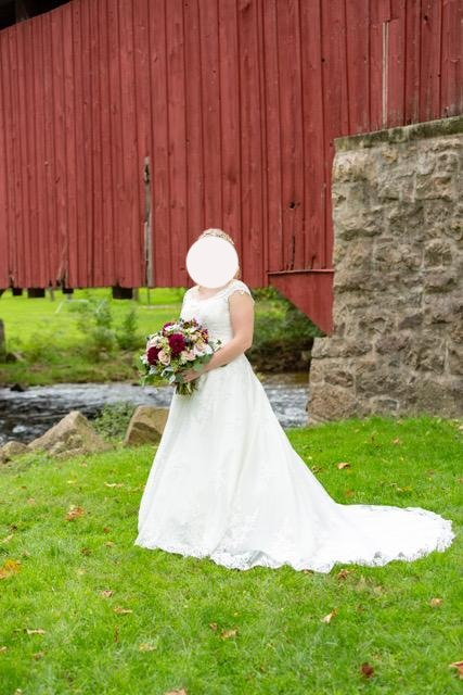 Maggie Sottero 'Kaitlyn' size 14 used wedding dress front view on bride