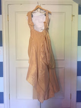 Load image into Gallery viewer, Christian Dior 'Galliano Peach Velvet' size 4 used wedding dress back view on hanger
