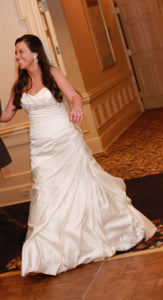 Essence Of Australia 'Ivory Satin 5852' size 8 used wedding dress front view on bride