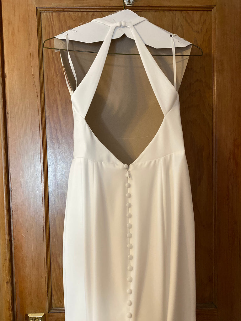 Mikaella 'Halter 2150' size 6 used wedding dress back view on hanger