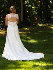 Casablanca '2072' size 12 used wedding dress back view on bride