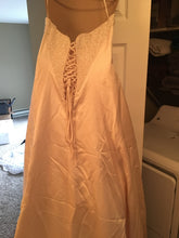 Load image into Gallery viewer, Maggie Sottero 'Strapless Beaded' size 14 used wedding dress back view on hanger