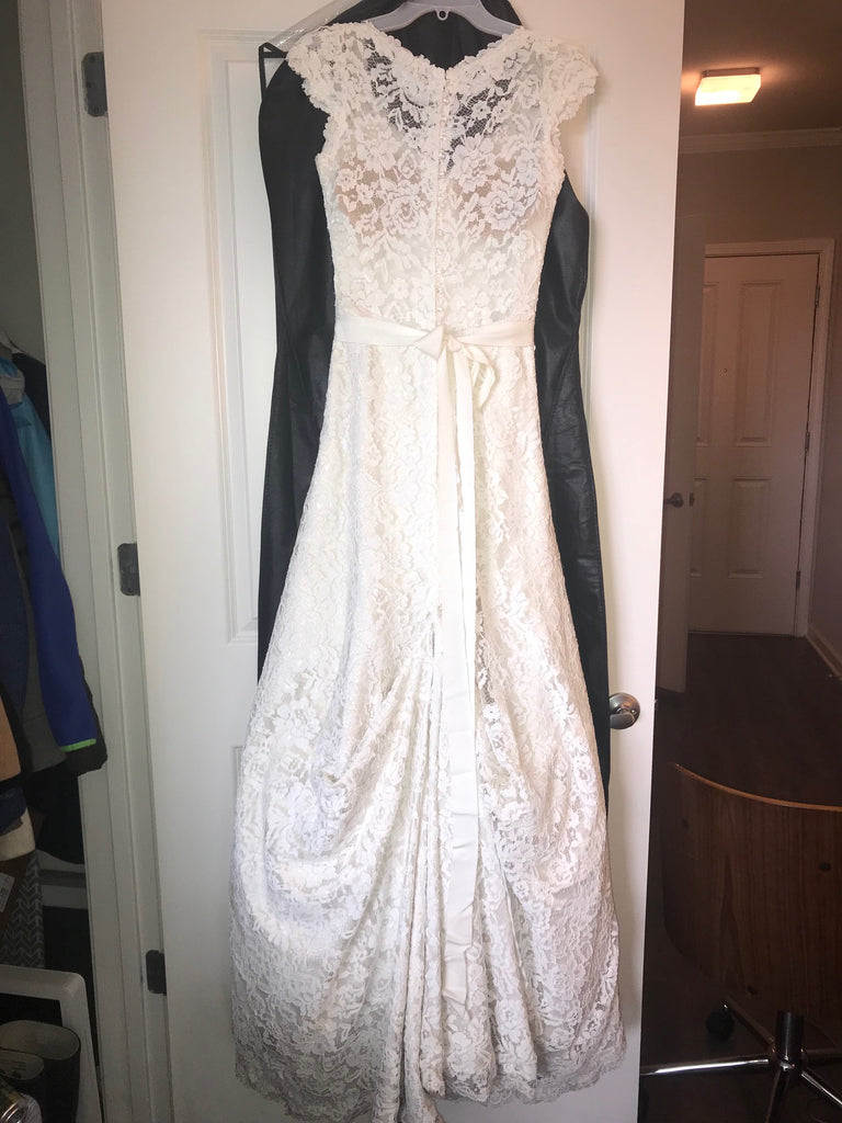Essense of Australia 'Stella York' size 2 used wedding dress back view on hanger