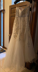Reem Acra 'Dreamy' size 12 used wedding dress back view on hanger
