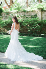 Kenneth Winston '1573' size 4 used wedding dress back view on bride